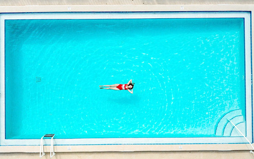 Woman in a large swimming pool