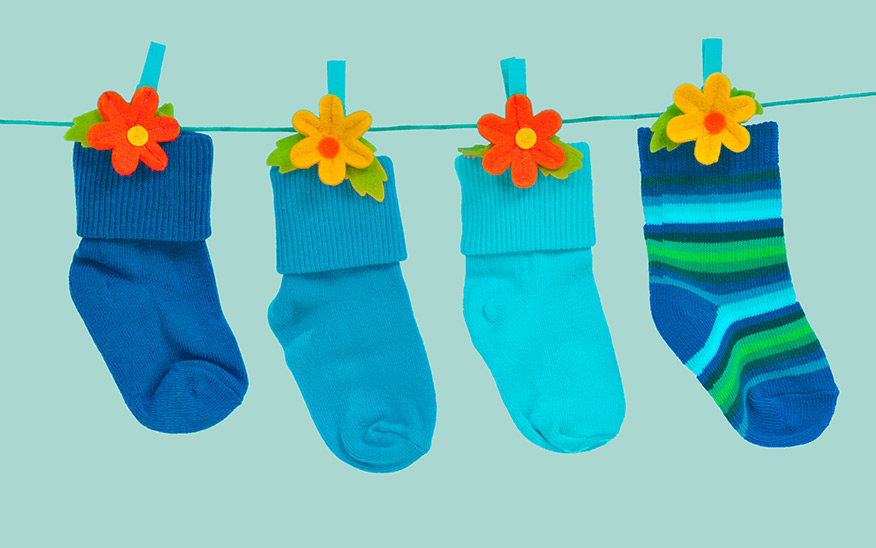 Blue baby socks on a washing line